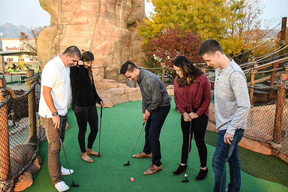 Boondocks - Group Playing Mini Golf