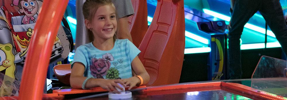Boondocks - Young Girl Playing Air Hockey
